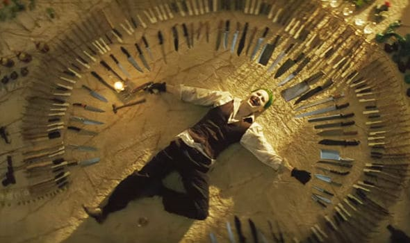 The-JOker-lying-in-a-circle-of-knives-443040